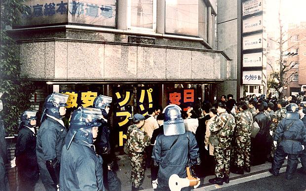 Riot policemen surround the Tokyo headqu